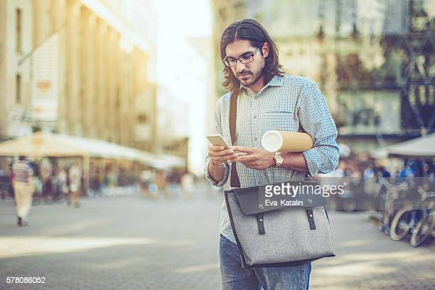 Young businessman in a city