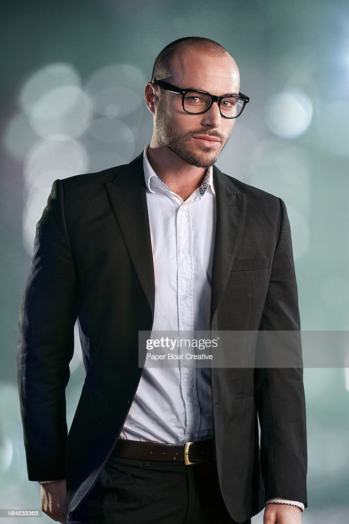Young businessman in black suit and dark glasses