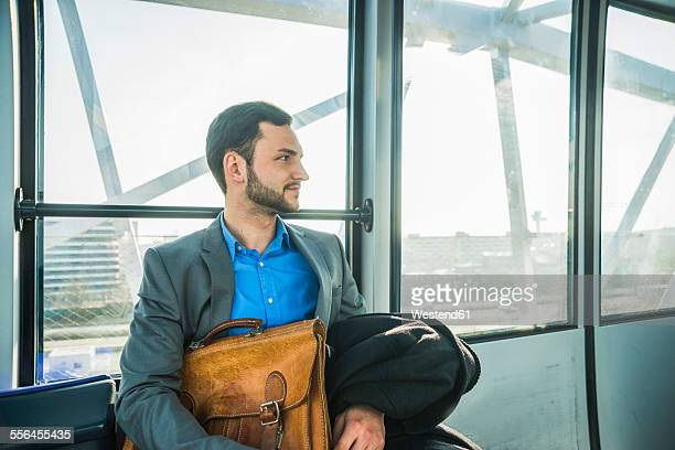 Young businessman in bus at the airport
