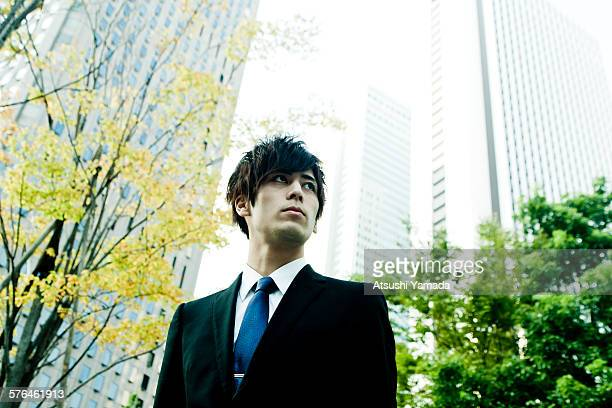 Young Businessman in city location