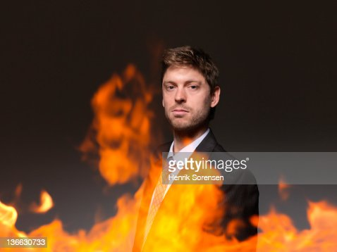 Young businessman in fire