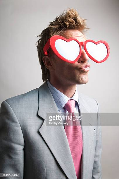 Young Businessman in Heart Glasses Making Kissy Face