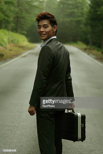 young businessman in the forest