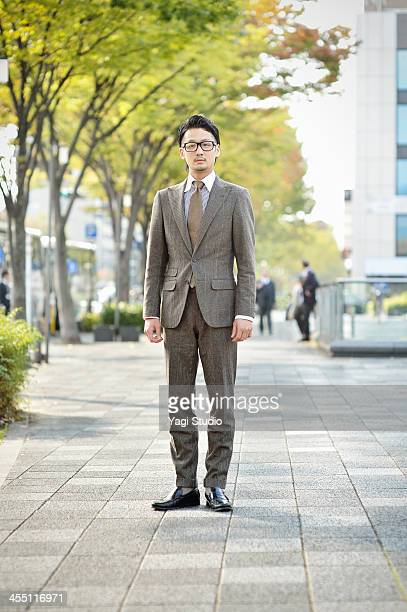 Young businessman in town