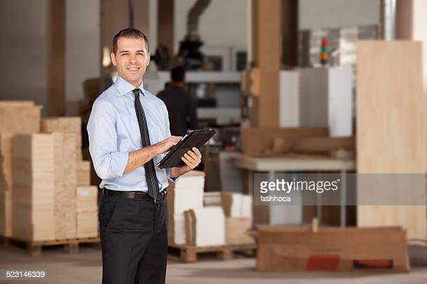 Young Businessman In Warehouse Checking