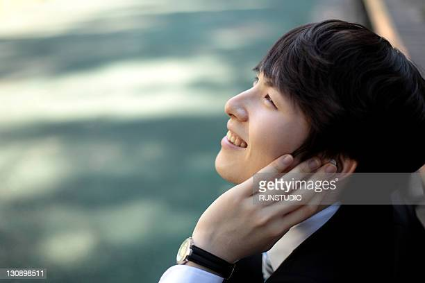 young businessman listening to music