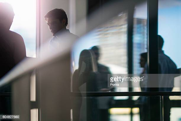 Young businessman looking at colleague