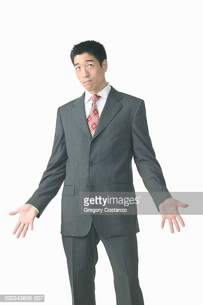 Young businessman looking upwards