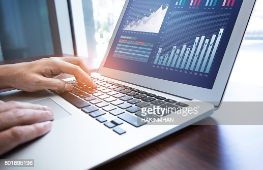Young businessman multitasking using laptop.working concepts : Stock Photo