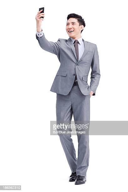 Young businessman photonic with mobile phone