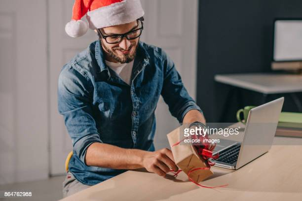 Young businessman preparing gifts