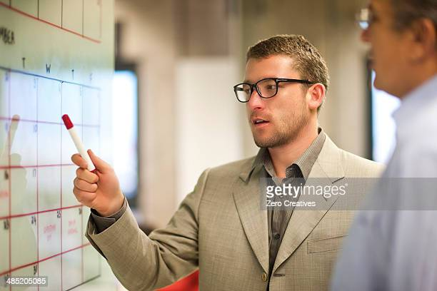 Young businessman presenting ideas to client