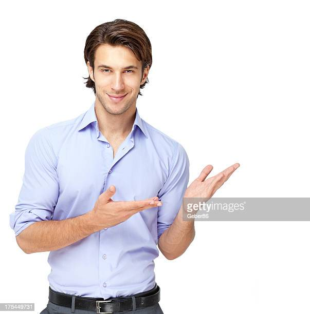 young businessman presenting over white background