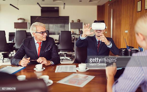 Young businessman presenting virtual reality simulator