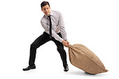 Young businessman pulling a burlap sack isolated on white background