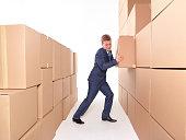 Businessman pushing box