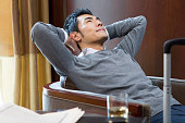 Young businessman resting in hotel room