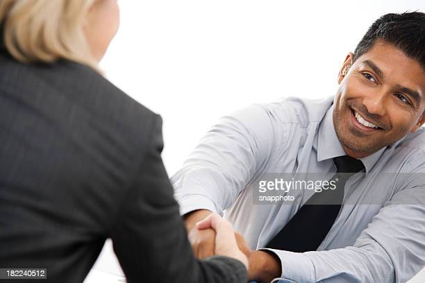 Young Businessman Shaking Hands with Female Client