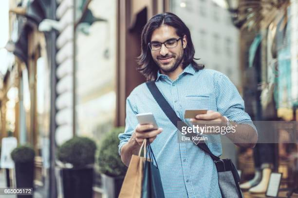 Young businessman shopping in the city