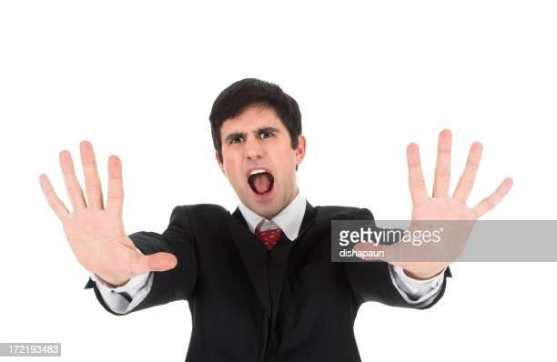Jeune homme d'affaires montrant ses palmiers et yelling