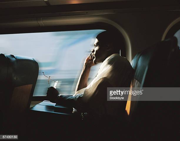 Young businessman sitting in a train looking out
