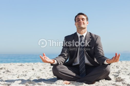 Young businessman sitting with legs crossed relaxing : Foto de stock