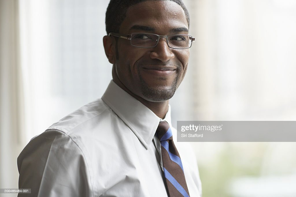 Young businessman smiling : Stock Photo