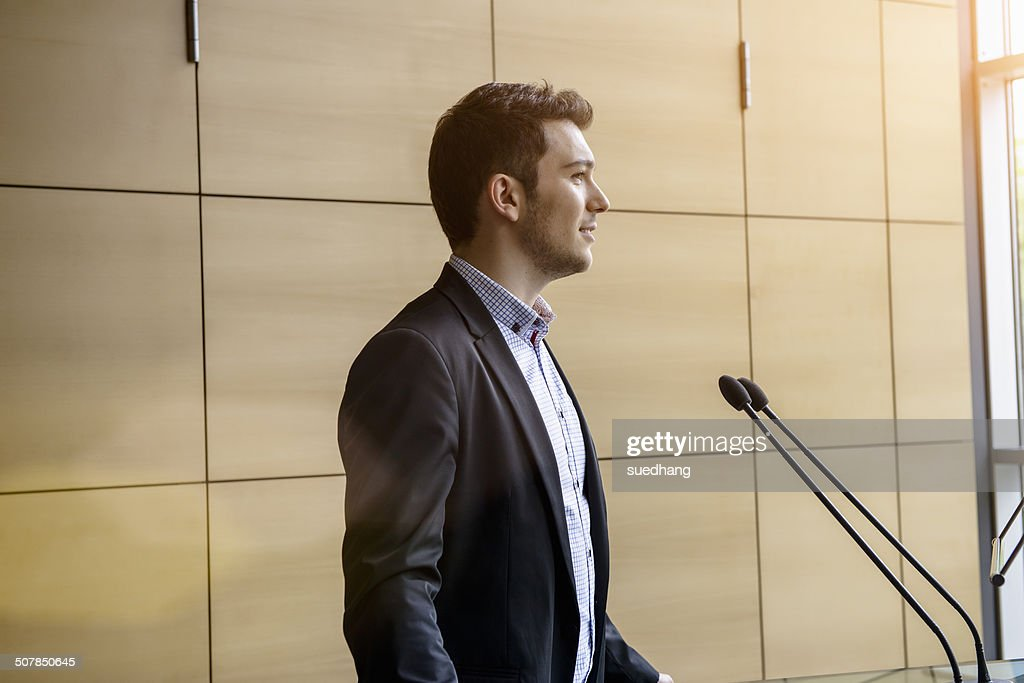 Young businessman speaking in conference