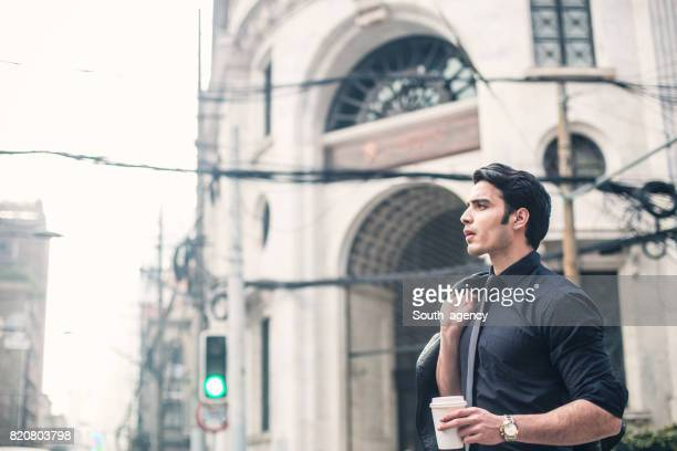Young businessman standing in the city