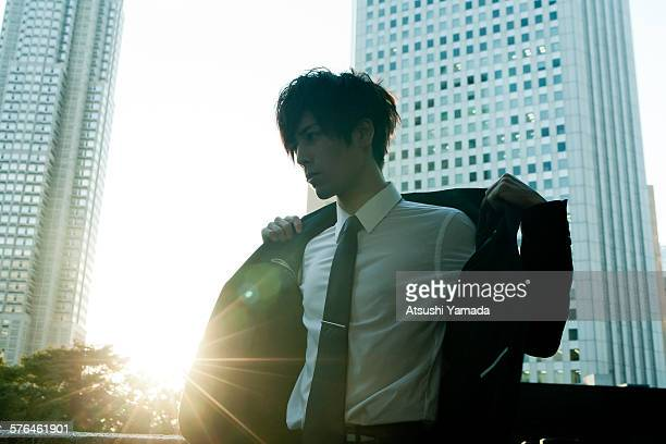 Young Businessman taking off jacket