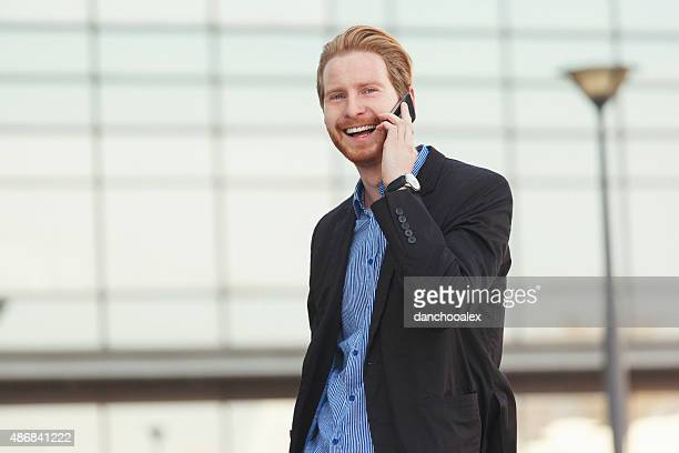 Young businessman talking on the smart phone