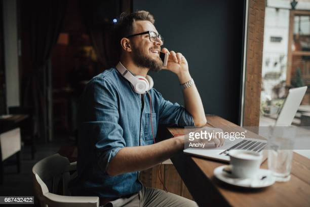 Young businessman talking with his partner over the phone
