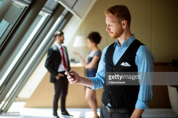 Young businessman texting message