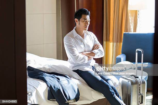 Young businessman thinking in hotel room