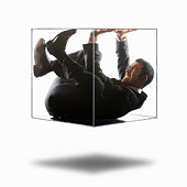 Young businessman trying to push his way out of transparent box