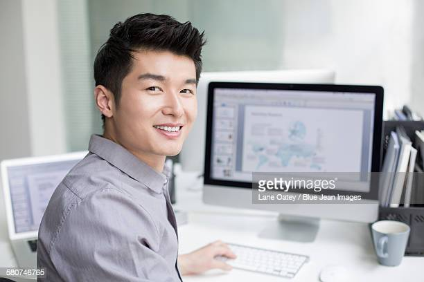 Young businessman using computer in office