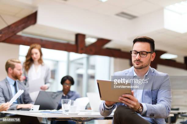Young businessman using digital tablet in the office
