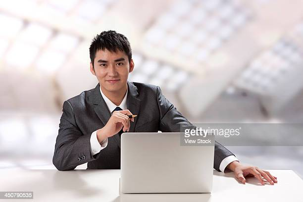 Young businessman using laptop