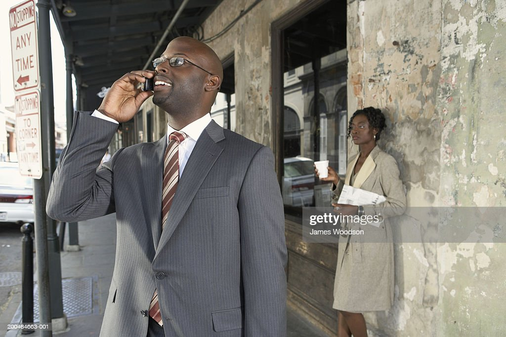 Young businessman using mobile phone : Stock Photo