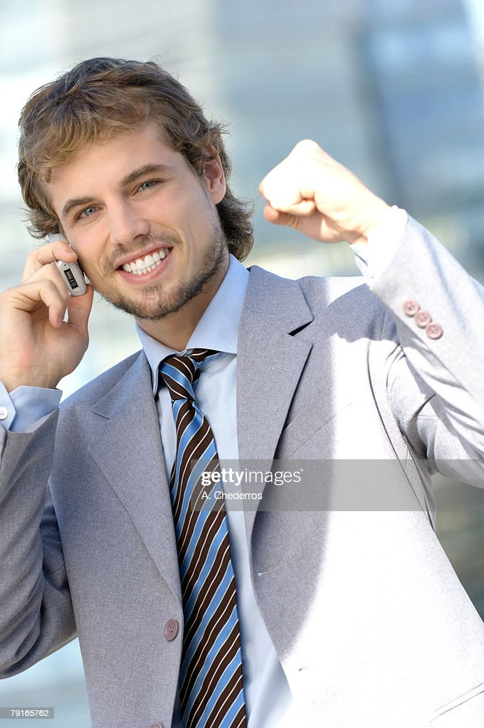 Young businessman using mobile phone, portrait : Stock Photo