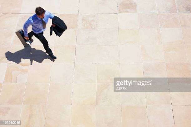 Young businessman walking in an open area