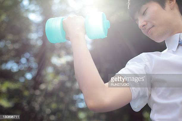 young businessman with a dumbbell