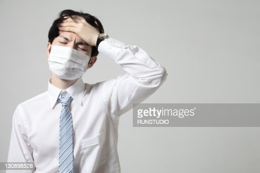 young businessman with a mask,bad condition : ストックフォト