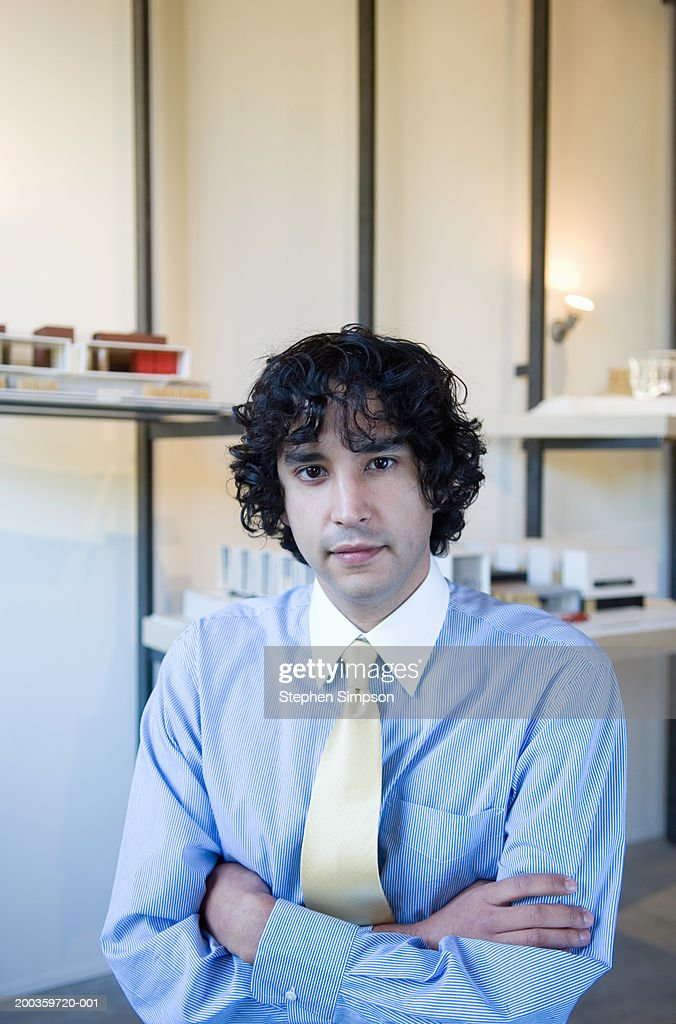 Young businessman with arms crossed, portrait : Stock Photo