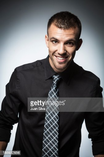 Young Businessman With Black Shirt And Tie Stock Photo | Getty Images