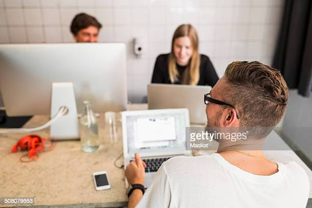 Young businessman with colleagues working in office