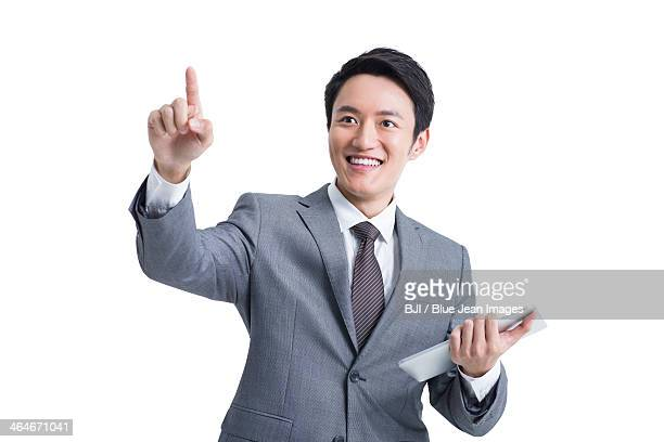 Young businessman with digital tablet pointing