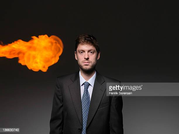 Young businessman with fireball