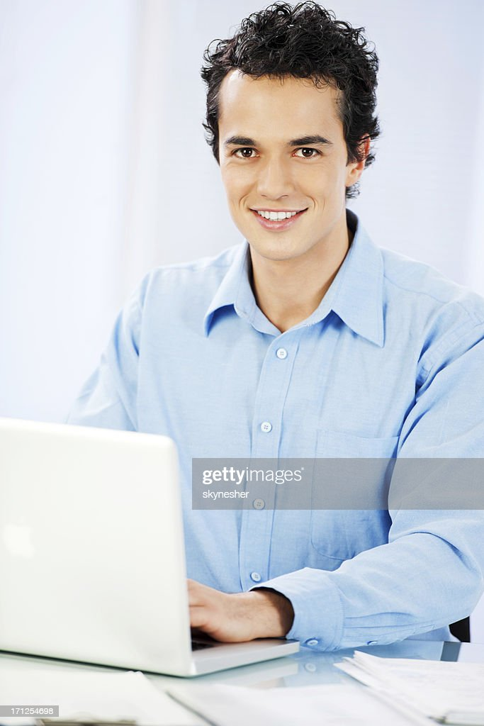 Young businessman with laptop. : Stock Photo