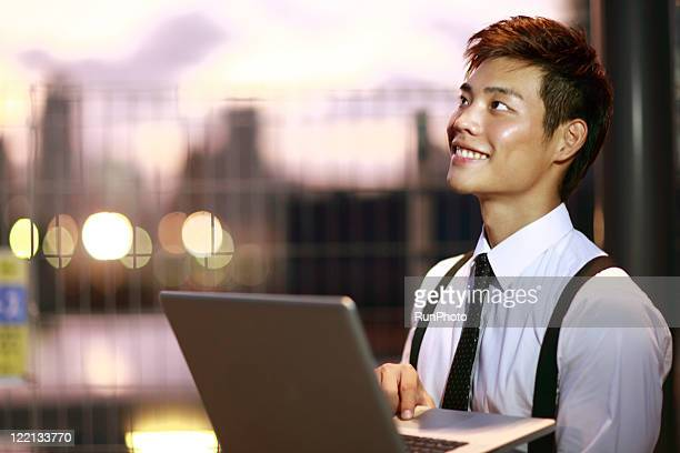young businessman with PC of the evening hours